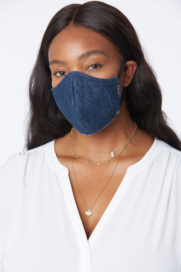 Stay comfortably safe wearing this reusable protective facial mask. With a soft outer shell, it has adjustable ear loops and is designed to fit the contours of your face for longer wear and optimal coverage. Each mask is uniquely handmade in Los Angeles from remnant fabric, so colors and patterns may vary. Approved for non-medical use only. Item is FINAL SALE. | NYDJ Women's Protective Face Mask in Dark Indigo, Regular, Size: EA