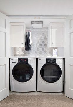 Stainless Steel tile in laundry room: Found at https://www.subwaytileoutlet.com/