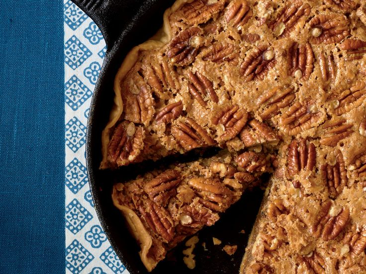 Utterly Deadly Southern Pecan Pie Recipe | When it comes to the holiday season, there's nothing better than the classics, and we all know that Thanksgiving dinner isn't complete without a pecan pie. Once you've made a pecan pie in a cast-iron skillet, you may never go back to a pie plate. This technique is easy, and the result is an authentic pecan pie, a bit crispy, a lot tasty. Simply press a refrigerated pie crust into the skillet, sprinkle with sugar, top with the pecan mixture, and…