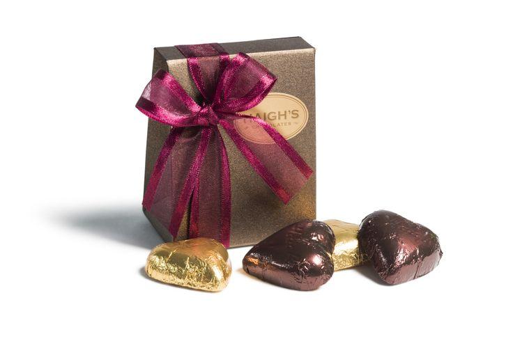 2 milk and 2 dark chocolate hearts in a ribboned bronze mini satchel.