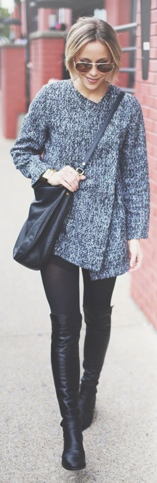 Thick sweater with mod detailing, black leggings or jeans, and black riding boots.