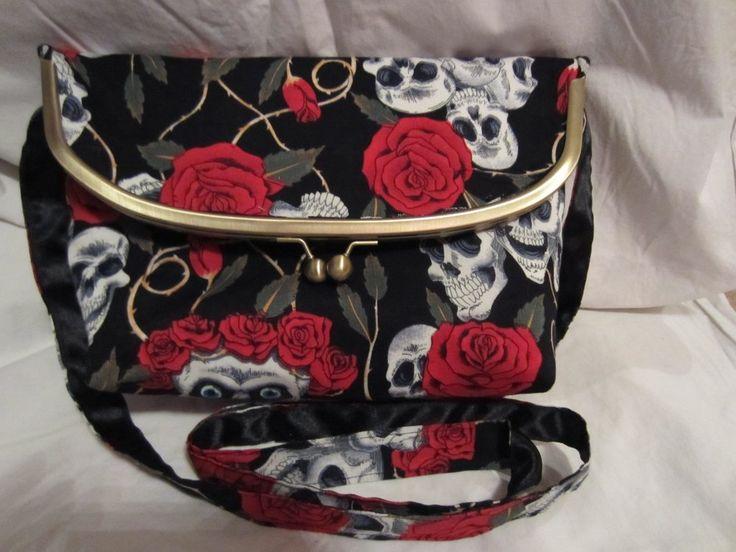 Handmade foldover frame bag in skull & roses print by Koolies Kreations at IAMA