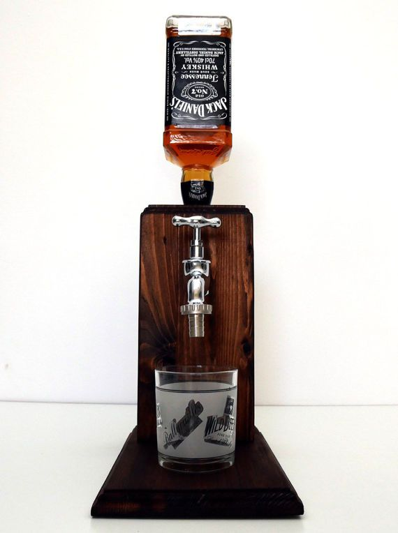 Hand made liquor dispenser with a chrome tap.  Fits regular sized bottles mainly up to 1 liter. Plastic drink safe fittings inside.  The dispenser system is built into a large solid block of wood. The wood is hand stained and painted with superior danish oil for an alcohol resistant finish.  Our system is easy to use, just turn the dispenser upside down insert an open alcohol bottle, turn it upright and youre done. No fittings need to be inserted and no holes need to be drilled, unlike many…