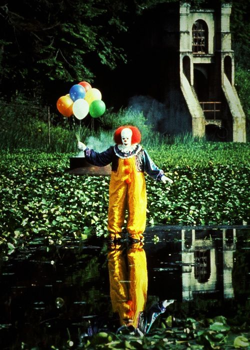 Tim Curry as Pennywise the Clown. This is why I hate clowns. Watching this movie as a child.