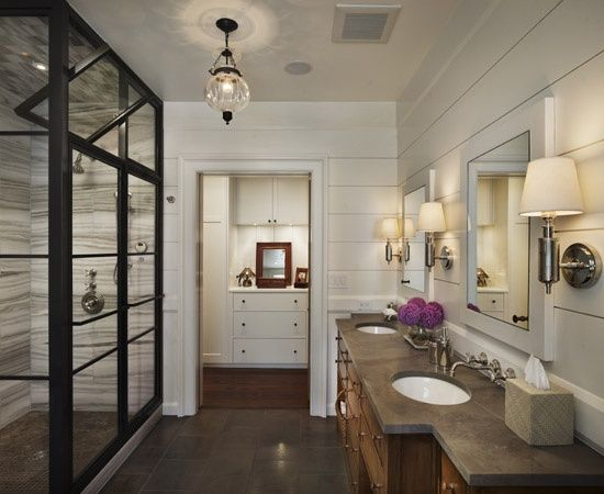 bathrooms - slate tiles slate floor metal shower stall glass shower bathroom hardwood floors freestanding tub tongue and groove walls bathroom pendant bathroom lighting floor-mount tub filler double bathroom vanity concrete countertops bathroom sconces white framed mirrors