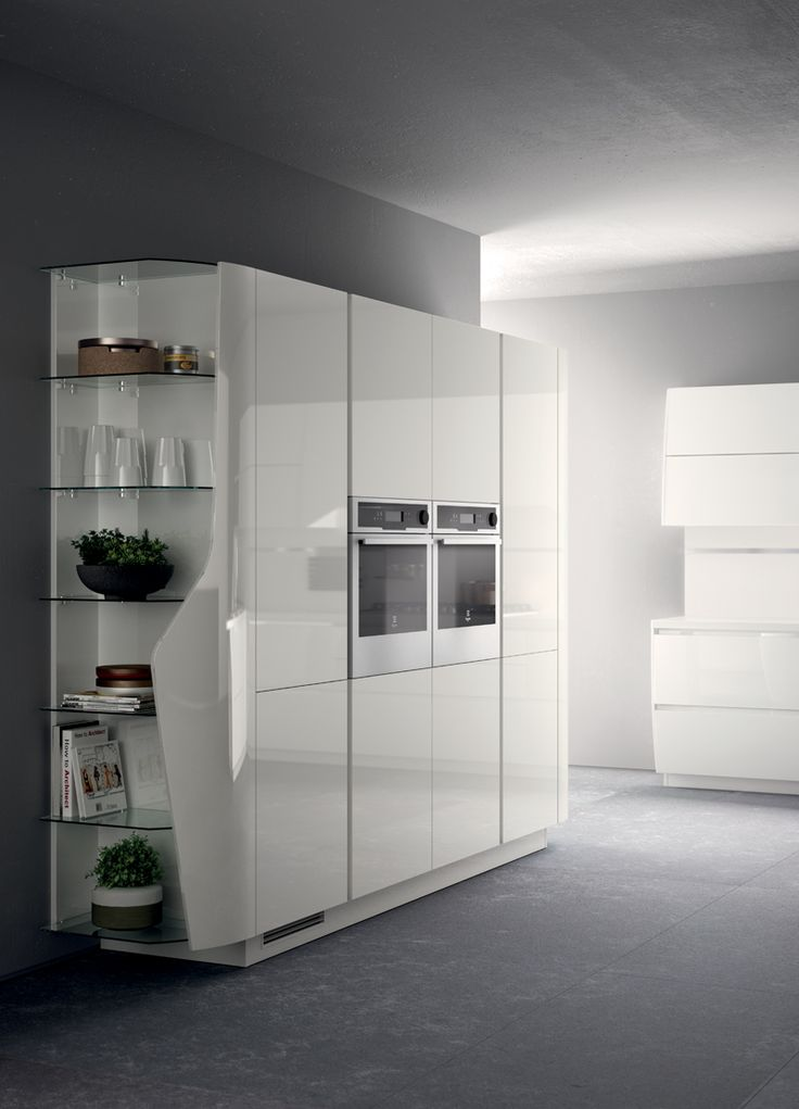 The special graphic design of the model also affects the open-fronted larder unit with curved end unit fitted with glass shelves.