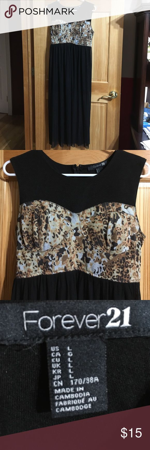 FOREVER 21 Cheetah Dress Padded cups, zipper on back, back is all black, the dress is above the knee with a black sheer overlay to the ankles, sleeveless And elastic waistband Forever 21 Dresses