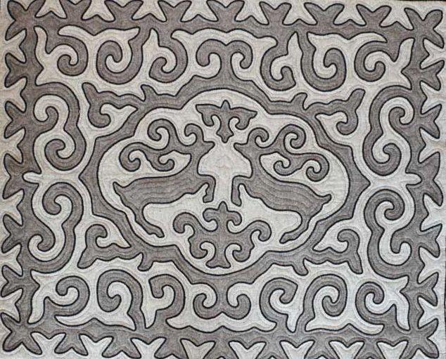 Elyk. Handmade shyrdak felt carpet with traditional symbol of two deers.