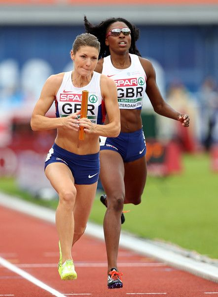 Kelly Massey of Great Britain takes the baton from Margaret Adeoye of Great Britain during their qualifying heat for the womens 4x400m relay on day four of The 23rd European Athletics Championships at Olympic Stadium on July 9, 2016 in Amsterdam, Netherlands.