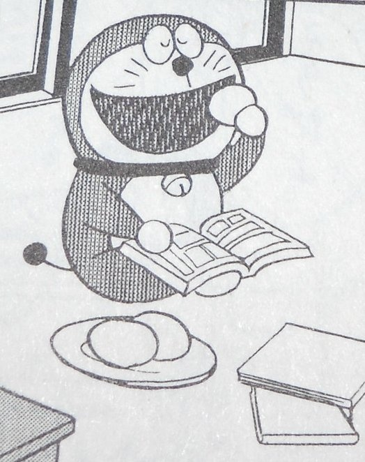Doraemon reading manga