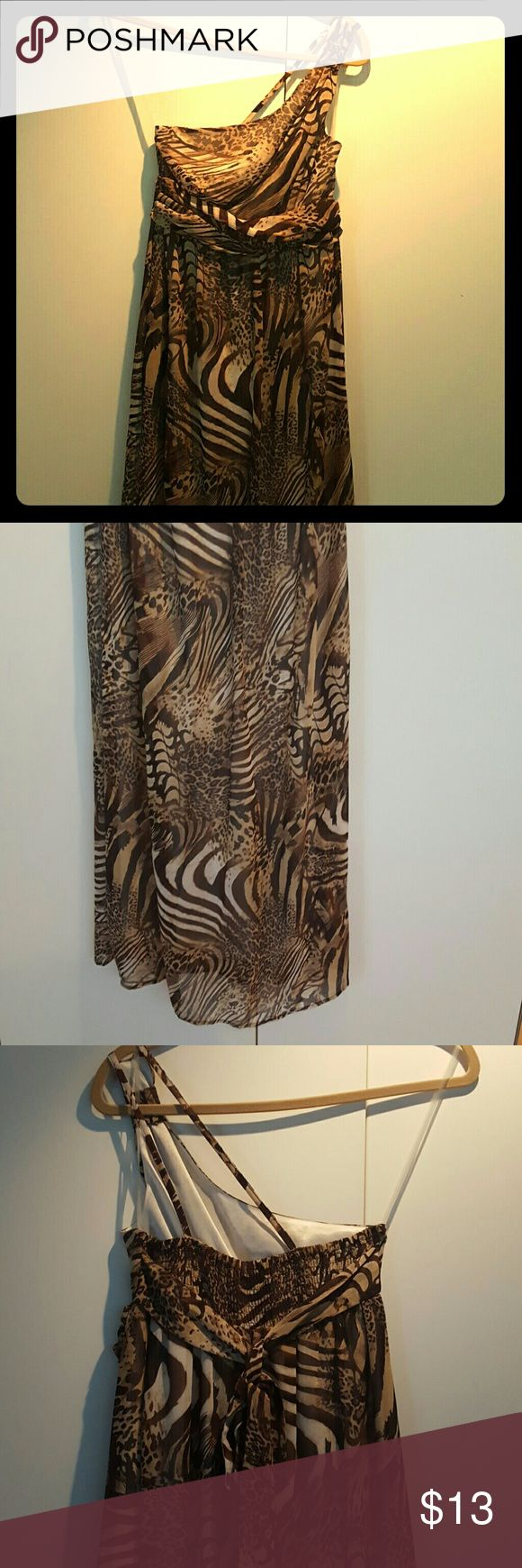 Brown & Beige animal print maxi dress Black & Beige one shoulder animal print maxi dress. Back of bodice is elasticized.  Gathered look detail under breast area and ties in back. Grassroots Dresses Maxi