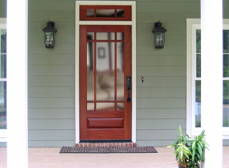 "DbyD-4001. This very popular 36"" X 80"" Craftsman Exterior Front Entry 9 Lite TDL (True Divided Lite) door is shown in Honduran Mahogany,  with Clear Beveled Glass. This particular unit is shown with a 12"" Mahogany Transom. The Baldwin Tahoe Hardware this customer has chosen is a fitting compliment to this unit."