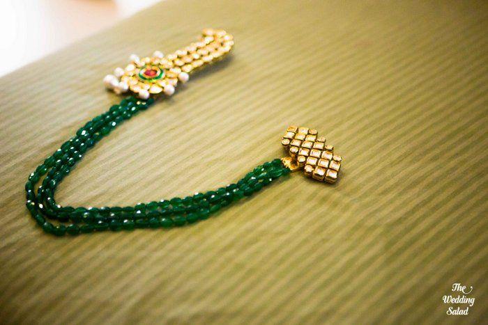 Indian Groom Wear - Groom wear accessory and pin | WedMeGood #wedmegood