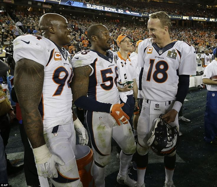 Manning celebrated with Super Bowl 50 MVP Von Miller (center) and DeMarcus Ware (left) aft...