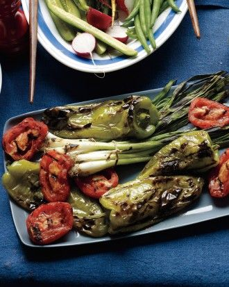 "See the ""Grilled Cubanelles, Tomatoes, and Scallions"" in our Our Best Grilling Sides gallery"