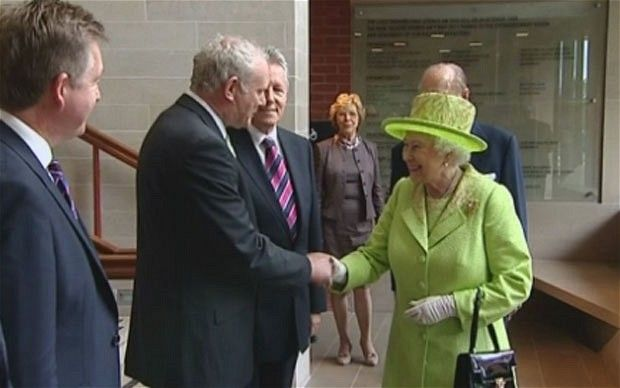 The Queen has shaken hands with the former IRA commander Martin McGuinness in a gesture that means as much to the peace process as her groundbreaking visit to Ireland last year.  Photo: ITN