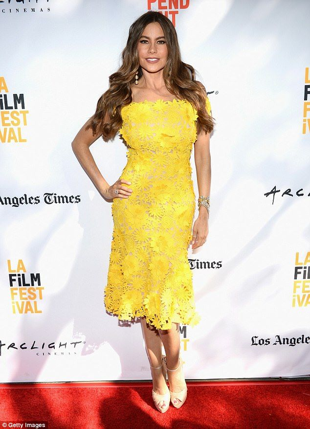Sunny: Sofia Vergara sported a yellow lace dress with nude heels as she attended the premi...44