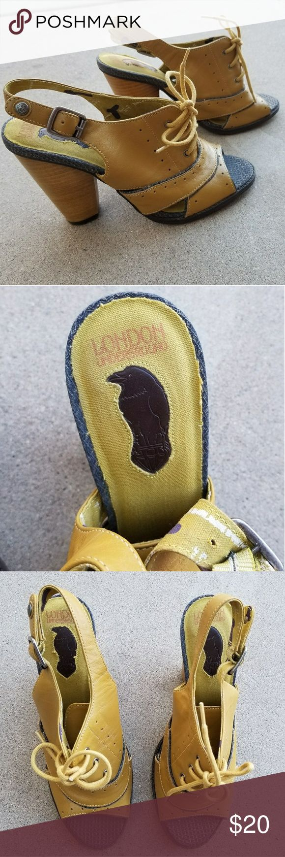 London Underground Chunky Heels. Size 8 These shoes are so cute and in excellent condition! They couldn't have been worn more than a couple times if that. Mustard yellow and brown/black with cute lace up top. If they were my size I would keep them! London Underground Shoes Heels