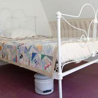 With its intricate scrollwork, detailed spindles and decorative bed-bolt cover, an antique iron bed can bring back the charm of yesteryear -- after you restore it. But before you do so, measure the bed's length to verify your modern mattress will fit the frame. If the bed frame was built between 100 and 150 years ago, chances are you'll need...