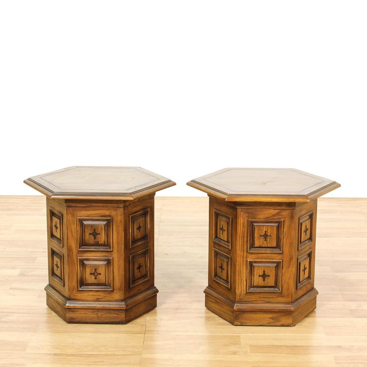 This pair of end tables are featured in a solid wood with a glossy walnut finish. These side tables have hexagon table tops with carved panel sides and large interior cabinets. Perfect as unique nightstands with storage! #americantraditional #dressers #nightstand #sandiegovintage #vintagefurniture