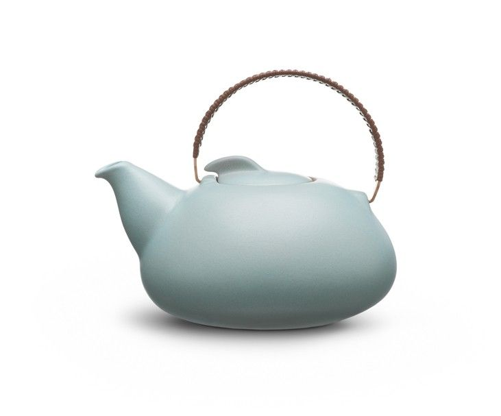 Wow.  First designed in the 1940's, large teapot from Heath Ceramics, Sausalito, California.  Copper handle hand wrapped in leather.  Matching simple handleless cups for vaguely Asian feel.  Now available in four colors. $196.00.