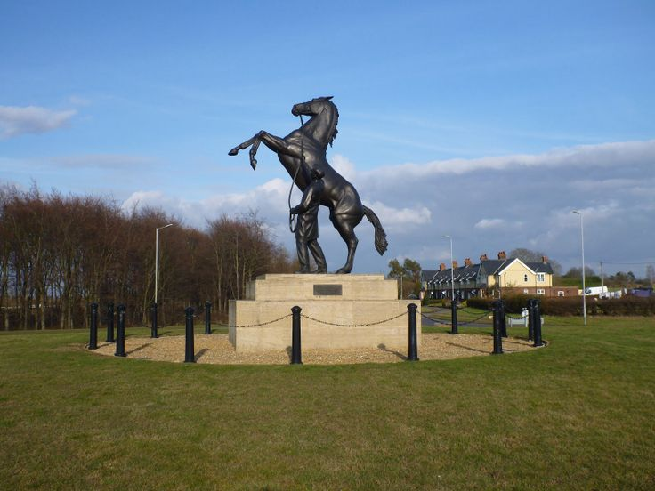 """""""The Newmarket Stallion"""" statue is situated at the main roundabout leading into Newmarket, located next to the entrance to the July Cup racecourse and the entrance to the National Stud. At one and half times life size, it really is breath taking and the photo hardly does it justice. To this day, no one knows who the horse in the sculpture is."""