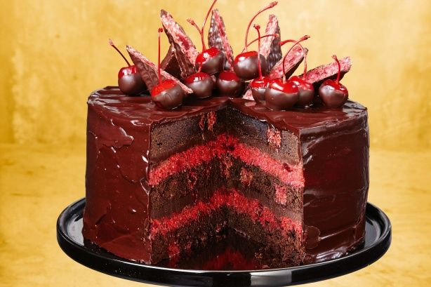 A cross between a mud cake and a brownie, this sweet treat is filled with Cherry Ripe bars and a cherry and coconut filling.