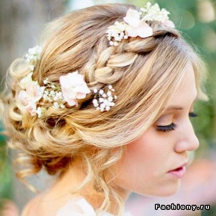A simple and charming hairstyle which incorporates your wreath right into it.  www.voguevowscelebrancy.com
