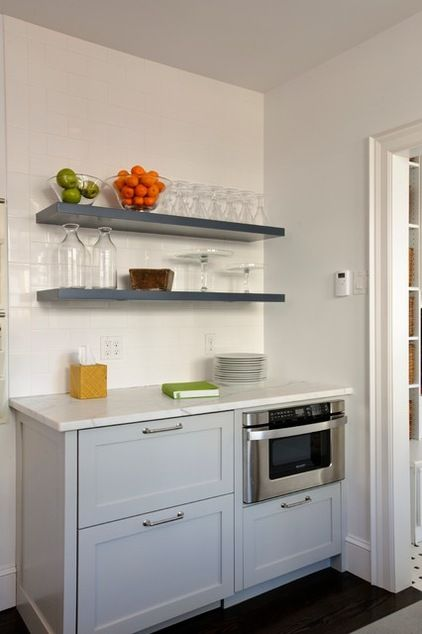 This snack station across from the breakfast nook has a microwave drawer and two refrigerator drawers for condiments and drinks. The locatio...