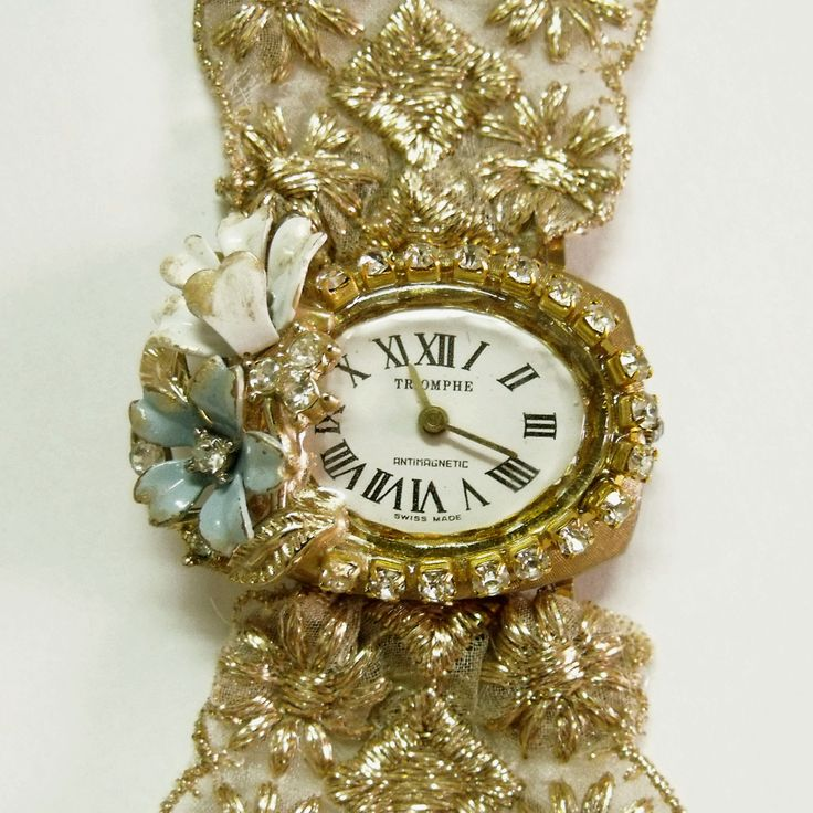 Vintage 70/80s Triomphe ladies Flowers rhinestones watch with metallic gold woven trim band revamped by me with vintage jewelry.$85.00..#vintagerhinestoneswatch#vintageflowerswatch#ladiesvintagerhinestoneswatch#upcycledladieswatch#ladiesrhinestonveswatch#helenaaleixo