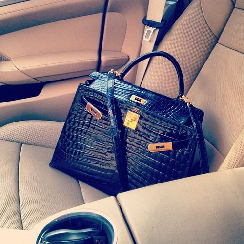 The right way to carry an Hermes Bag - Casual carried in an expensive car