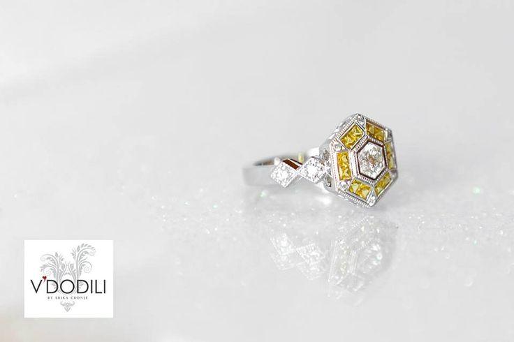 Diamonds and Yellow Sapphires set in Palladium.
