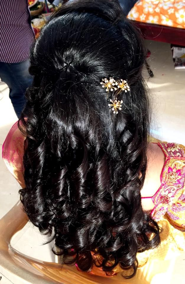 Indian bride's bridal reception hairstyle by Swank Studio. Find us at https://www.facebook.com/SwankStudioBangalore  #Saree #Blouse #Design #HairAccessory  #curls