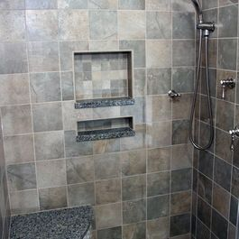 Good to have the shower cubbies/shelves to help keep functionality of a stand up shower. The bench is a nice touch too!