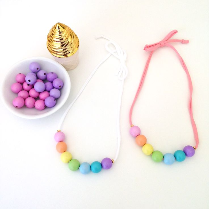 Beautifully handmade wooden geobead necklace of 7 small beads featuring all the pastel colours of the rainbow! Each bead is painted in lovely silky acrylic and finished with several coats of non-to...