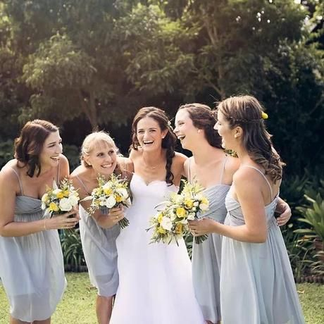 Yellow and grey rustic wedding. Grey bridesmaids dresses and yellow and cream bouquets. Flowers by www botanica-flowers.co.za and photography by www.abbyanderson.co.za