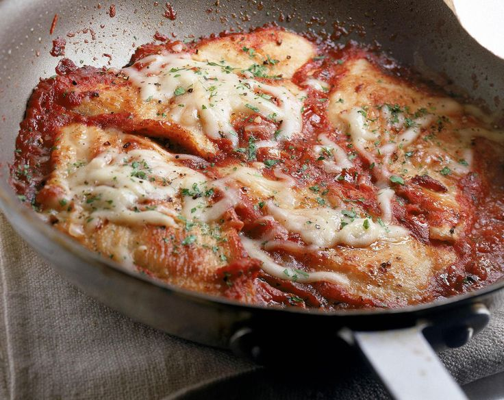 This easy, top-rated chicken Parmesan recipe is a family favorite! The chicken is breaded, browned, then baked to perfection with sauce and cheese.