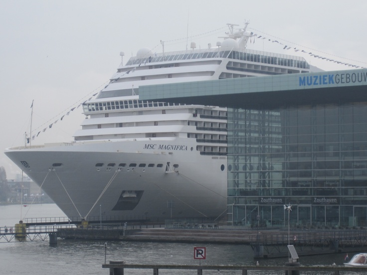@msc_cruises_uk @msccruisesusa #MSCMagnifica peeking out from behind the building in #Amsterdam! #cruise #MSCCruises