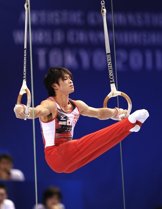 Kōhei Uchimura competes in the Still Rings Event at the 2011 Artistic Gymnastics World Championships in Tokyo, Japan.
