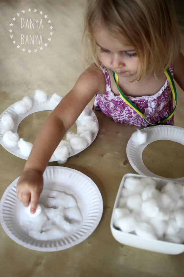 Pasting cotton wool to make paper plate sheep masks