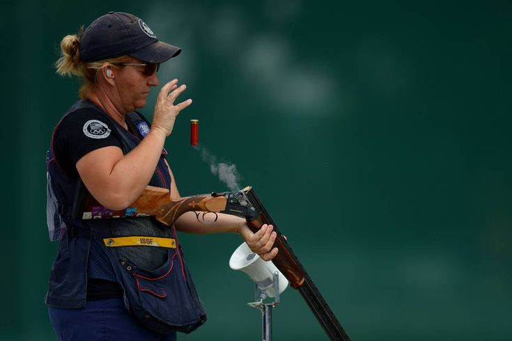 American Kim Rhode ejecting a spent cartridge during qualifiers for the women's trap event, at...