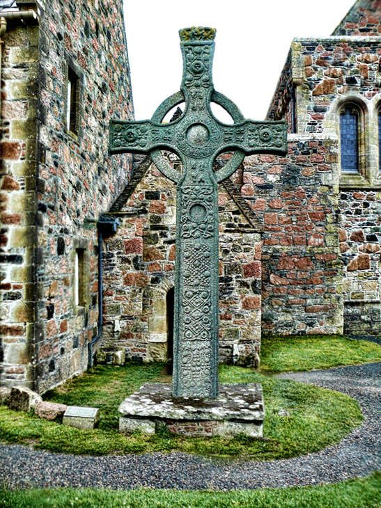 Saint John's Cross~ The religious center at Iona was started with St. Columcille, a priest who was cast out of Ireland for disagreeing with his kinsman, the king. He brought Christianity to the Pictish folk of Scotland, and established a dynasty of monasticism on the island.