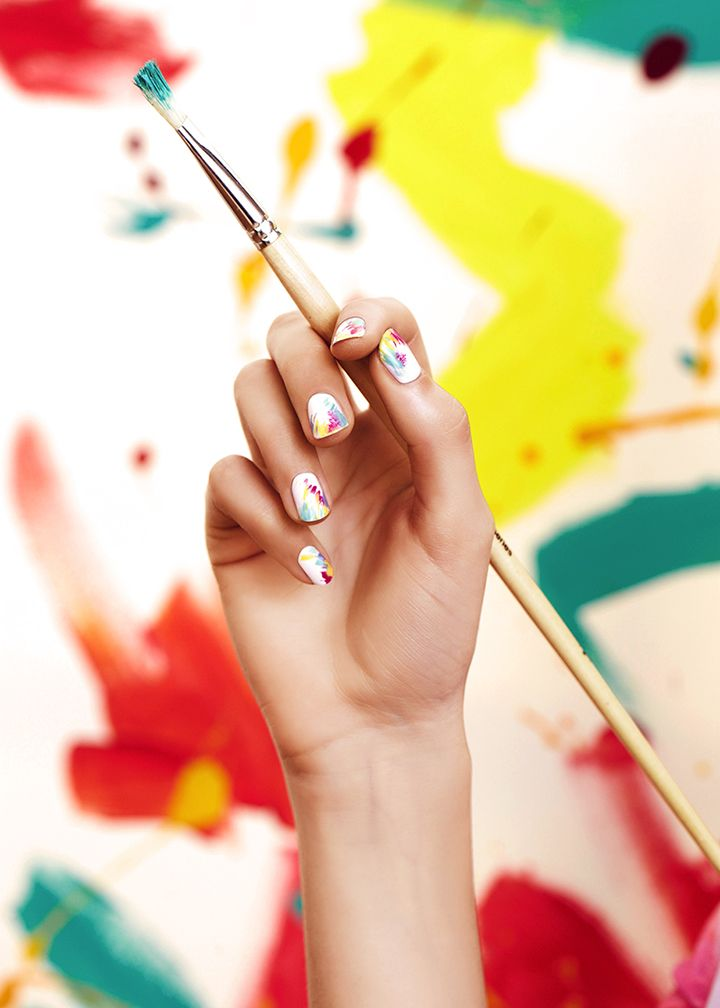 Daring, playful brush strokes on nails.