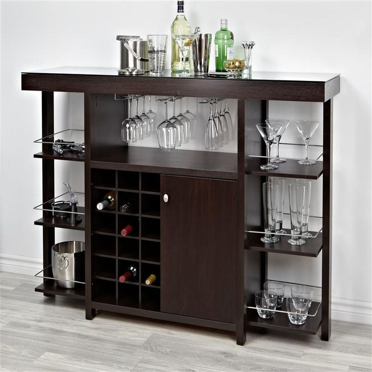 Entertain in style with the Brassex Geneva Bar Unit. This multi function, wood unit with an easy to clean glass top unit stores your wine glasses, wine bottles, glasses, bar tools and anything else you need for entertaining.