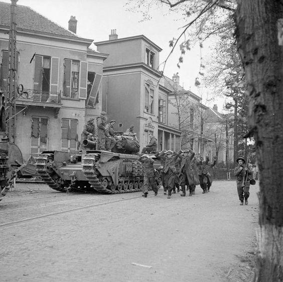 "German prisoners of war walk past the tank ""Churchill"" in Arnhem (Holland), April 1945"