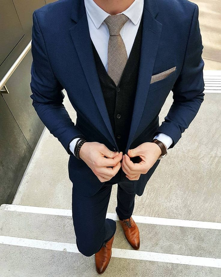 men's navy suit, black sweater vest, brown oxford shoes