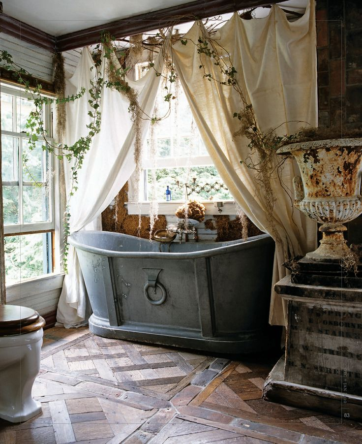 vintage outdoorsy shabby chic bathroom with large tub