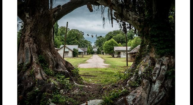 what?!?! the set of big fish was abandoned... cooooollll. i wanna go. The movie by Tim Burton, Big Fish, was available on netflix- hopefully it still is... its good :)  Haunting Photos of an Abandoned Film Set in Alabama | The Weather Channel