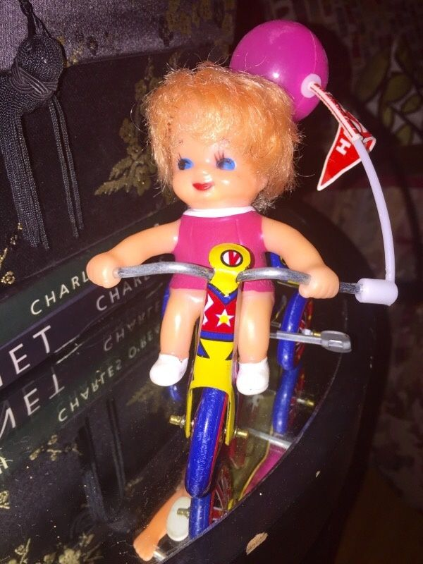 1970's  Tin Litho Wind up  Girl on tricycle   Works and is in Excellent condition