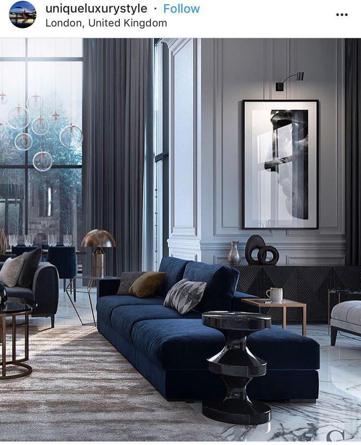 Fabelhaftes Wohnzimmer mit dunklen Farben und geraden Linien. Sofa, das lindert